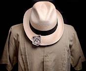 fedora hat and linen guayabera
